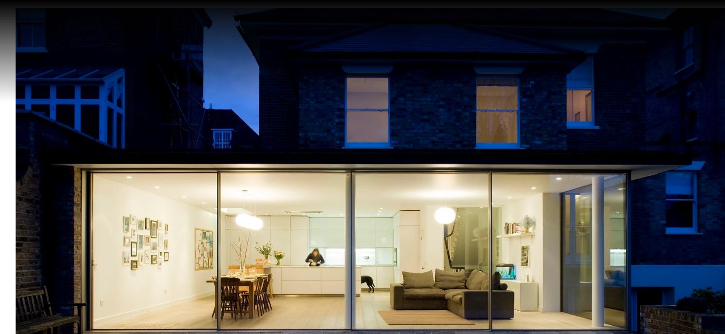 Brightly lit modern home from outside
