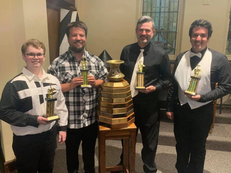 Bush League Champions holding trophies