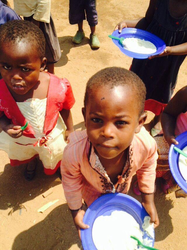 Boy at M'teza feeding programme