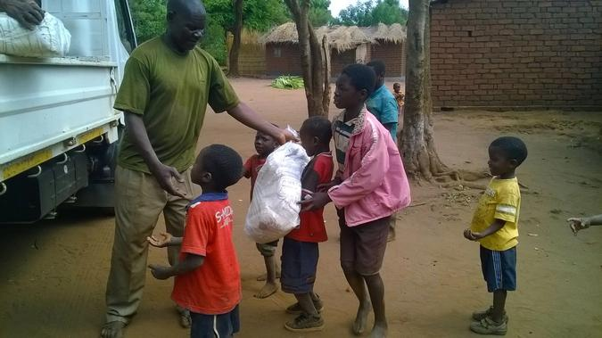Chiweza II Chief with CBCC children. The involvement of the local communities in our projects is essential to their success.