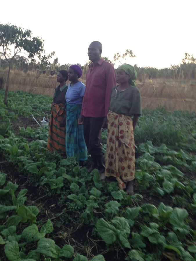 HIV+ support group in their vegetable garden