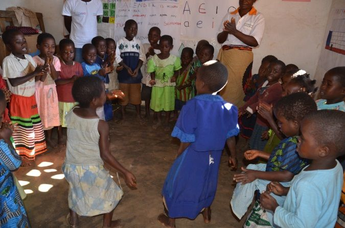 Children learning an action game at Masiye CBCC