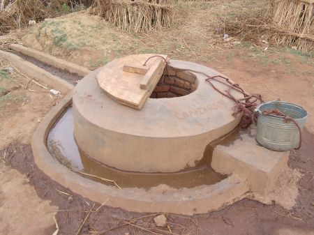 This well has been built up and has a cover