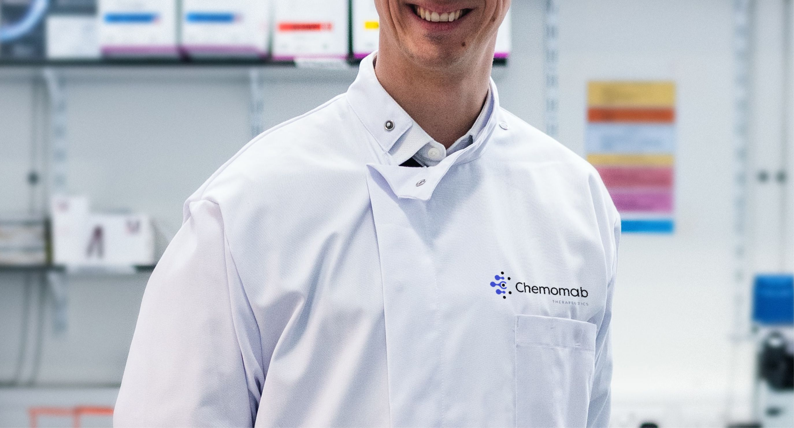 Scientist wearing branded Chemomab lab coat