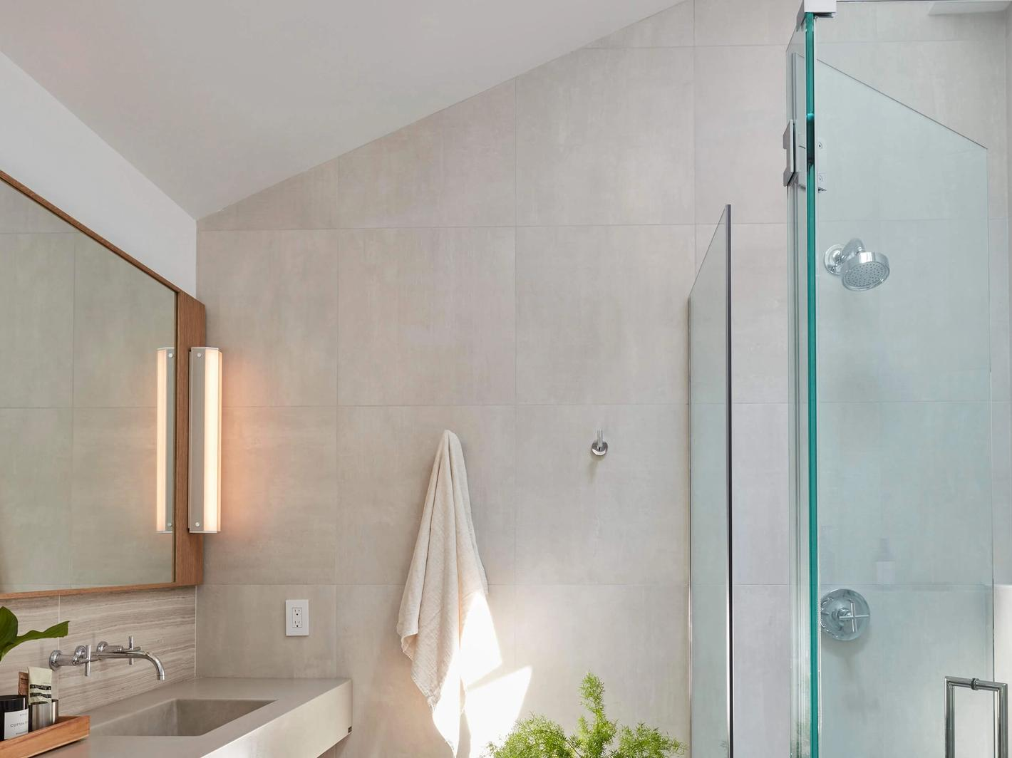 Branch sconce in natural (silver) anodized aluminum finish installed in bathroom