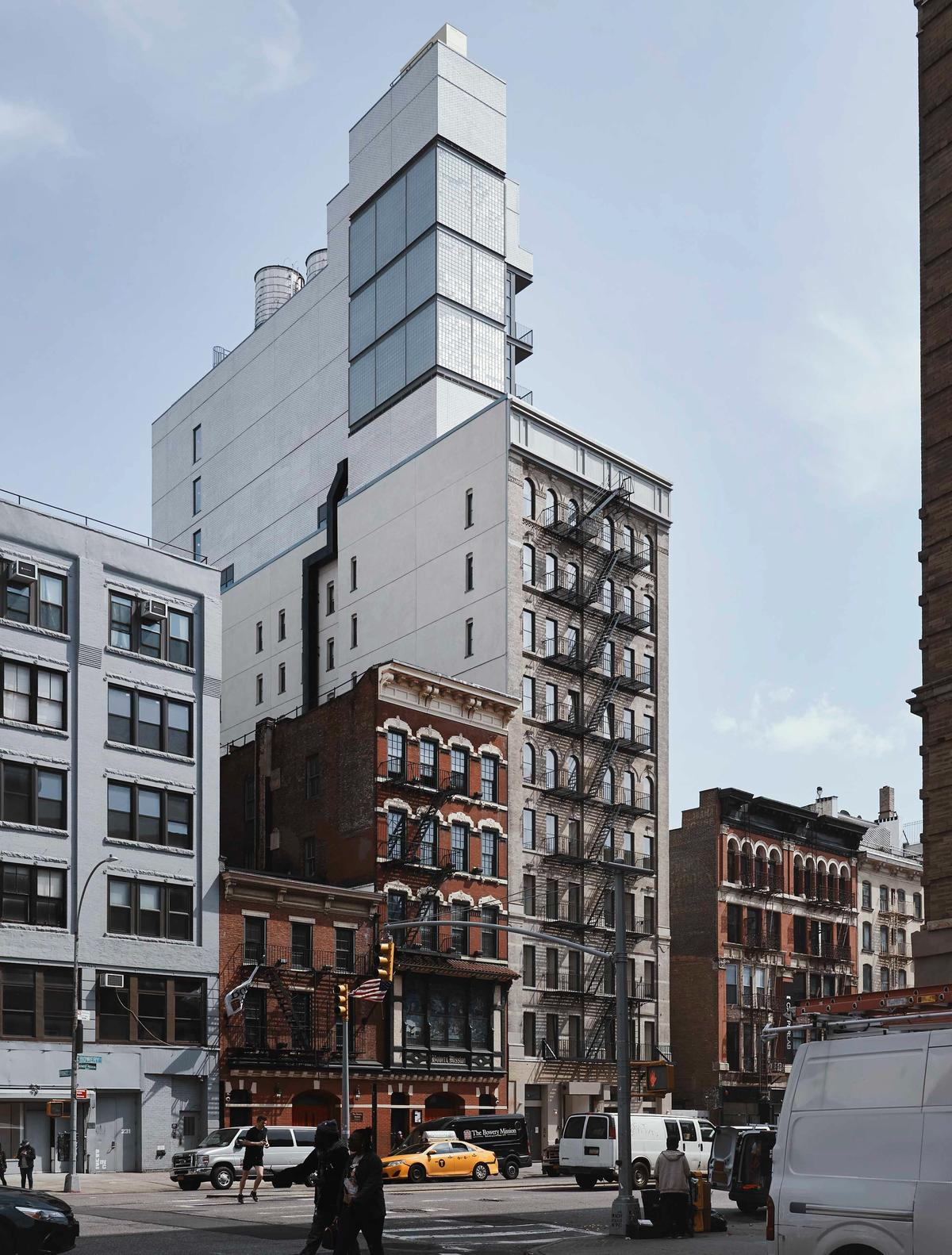 Sister City's facade, a combination of old and new, shining above the Bowery