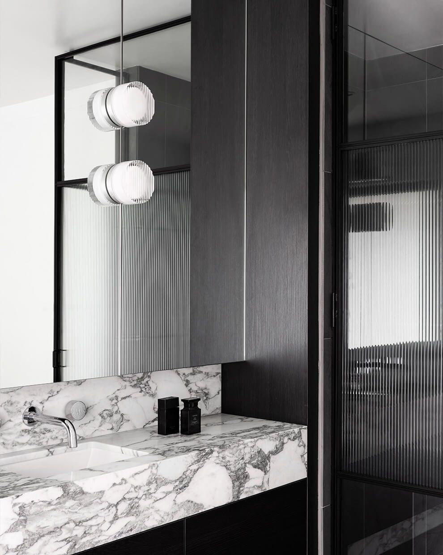 KBS Residence — Melbourne, Australia. Crisp sconce, white interior