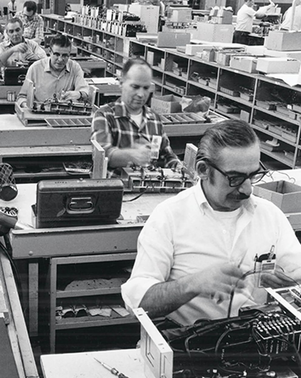 Workers assembling components