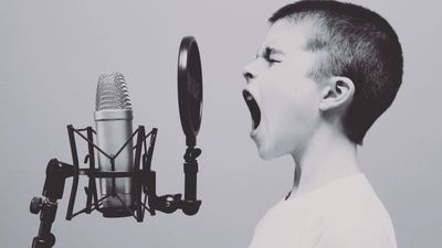 Image of boy singing