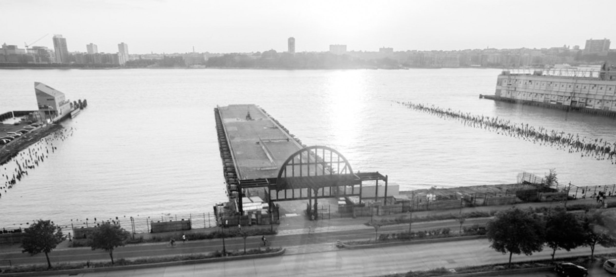 Black and white photo of the Cunard White Start Lines arch and Pier 54 from above