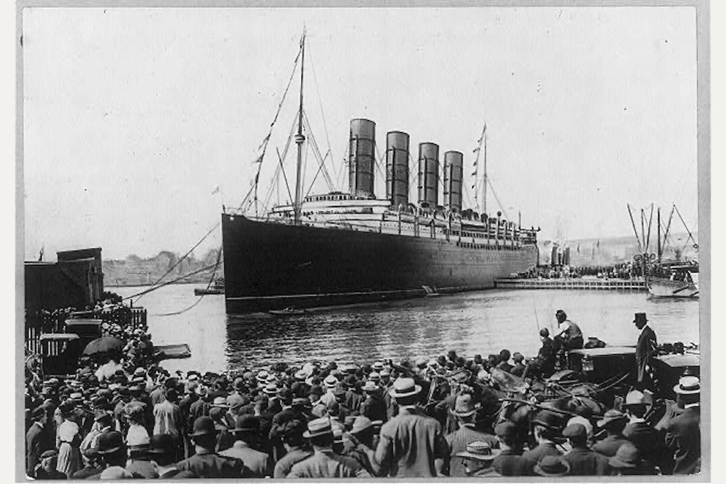 RMS Lusitania coming into pier with spectators in the foreground
