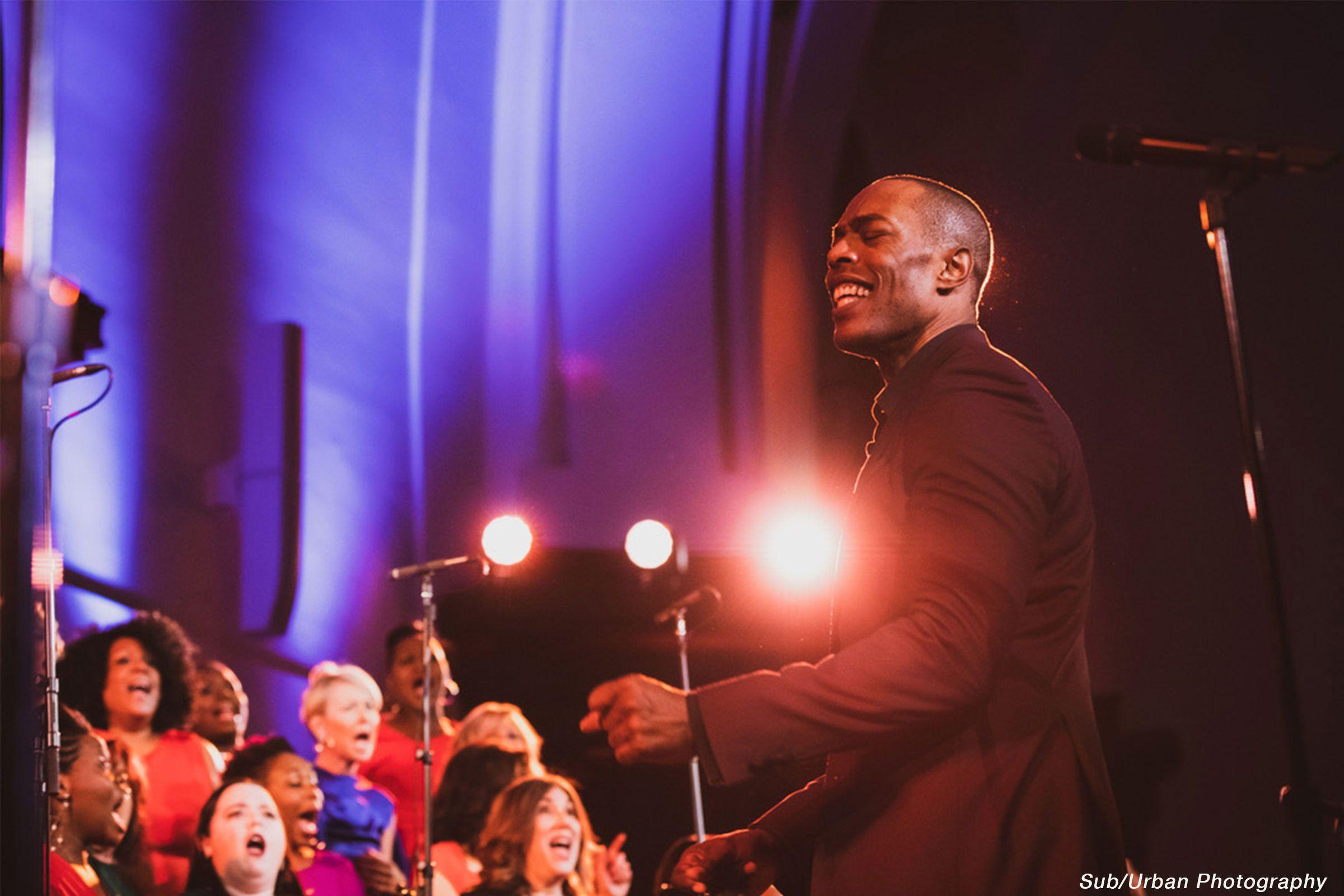 Man leading a choir