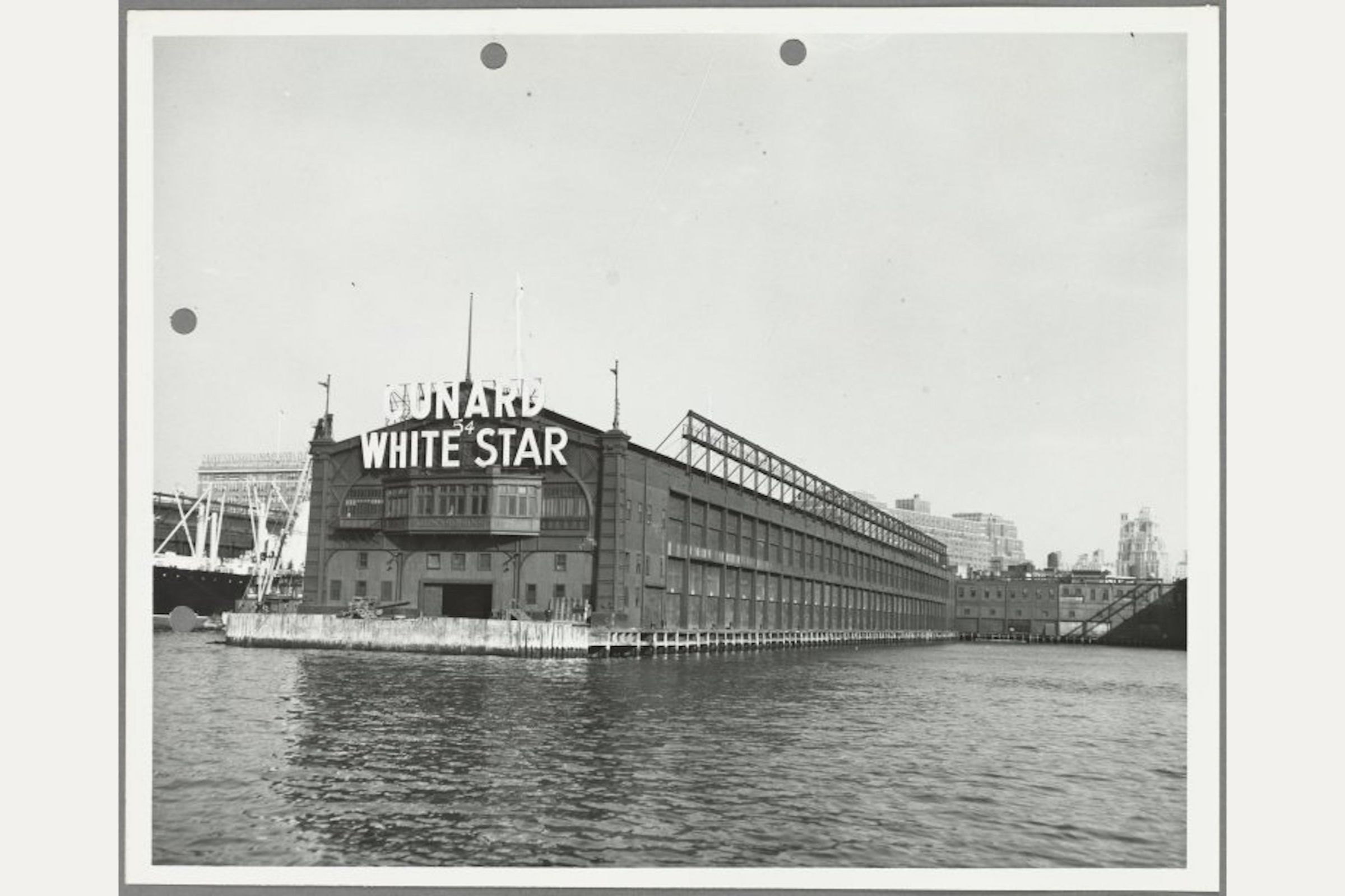 View of the Cunard White Star Line Pier 54 from the water