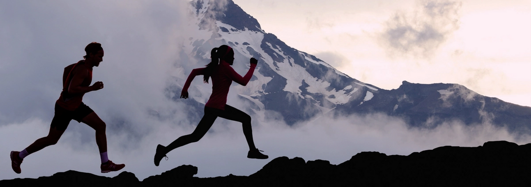 Healthy people jogging in the mountains.