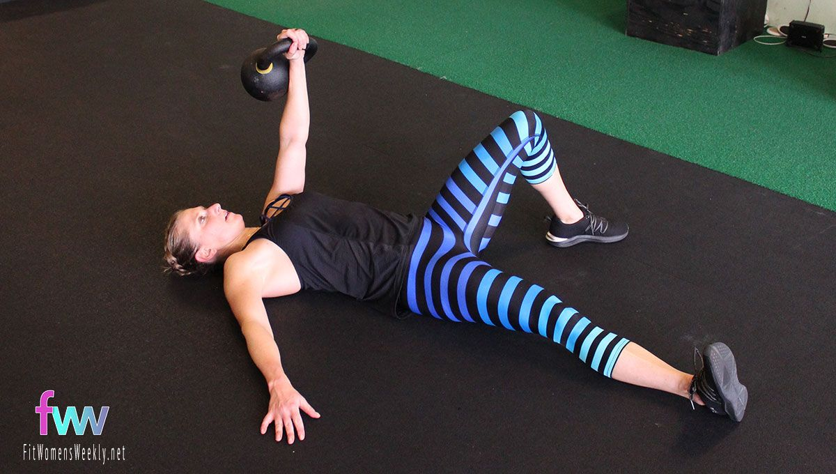 Starting position of the getup. Laying on your back with kettlebell extended up.