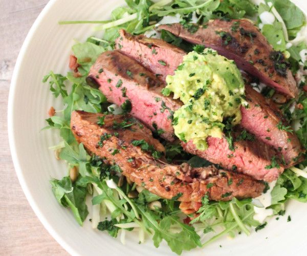 A steak salad drizzled in an avocado cilantro dressing.