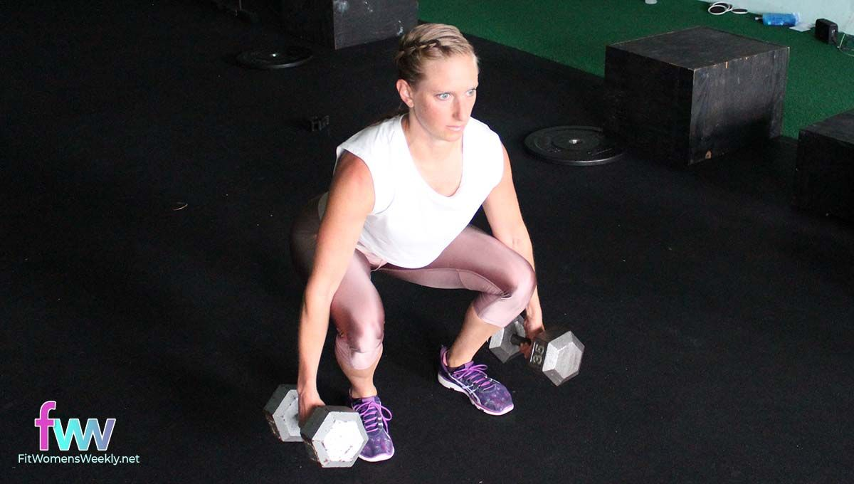 The bottom of a suitecase squat with two weights.
