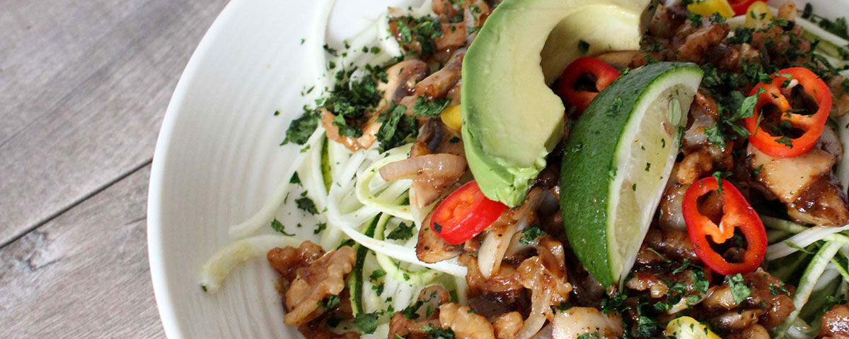 A vegan salad recipe made with zucchini zoodles and a walnut crunch.