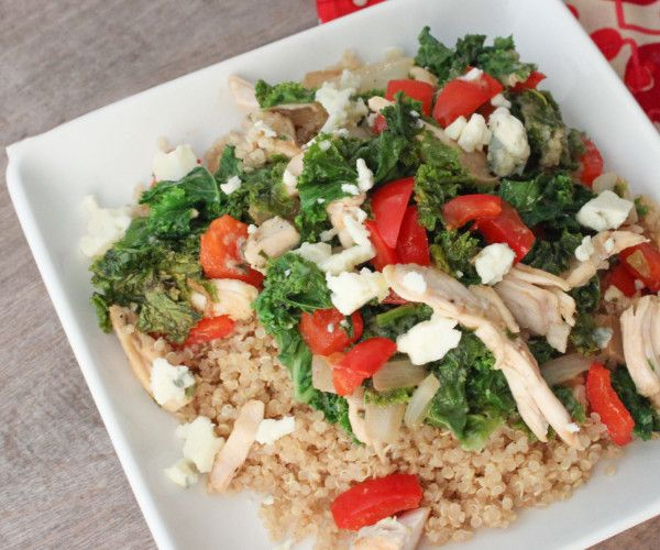 A plate of fresh balsamic chicken over brown rice and tomatos.