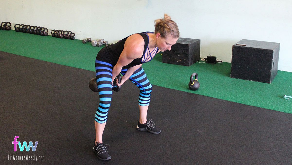 The bottom of the swing with two kettlebells. A good hip hinge position.