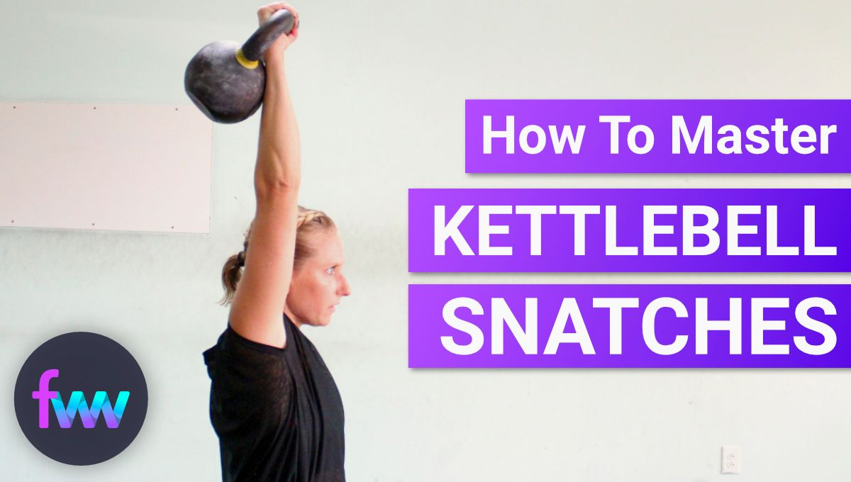 Kindal at the top of a kettlebell snatch