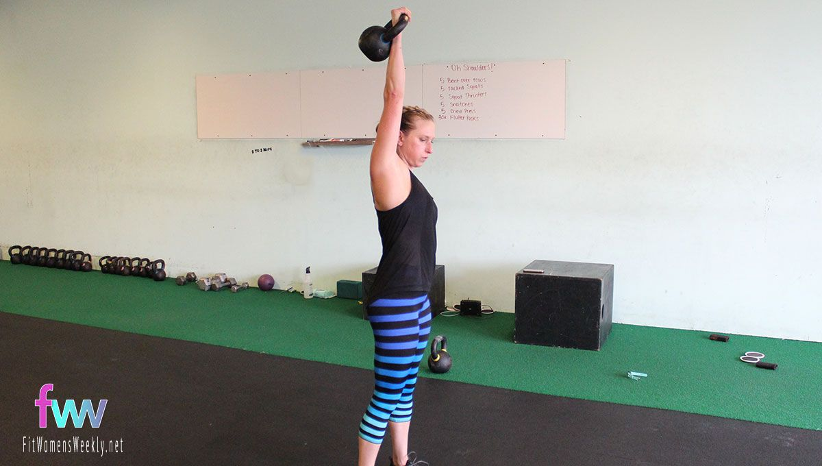 The top of a snatch just like normal. Reaching high and body tight.