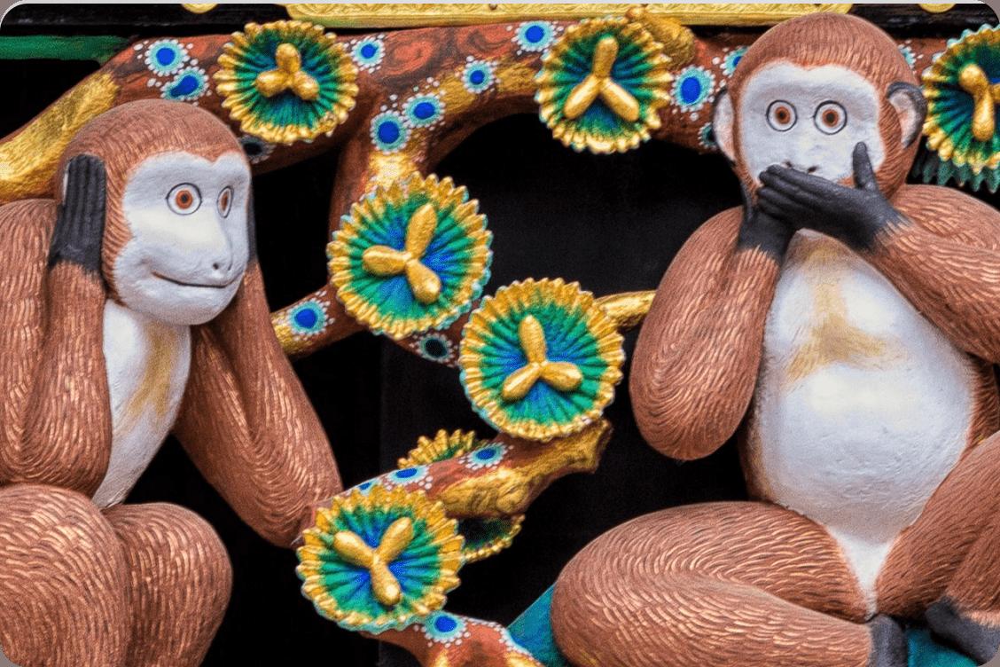Three plastic monkeys