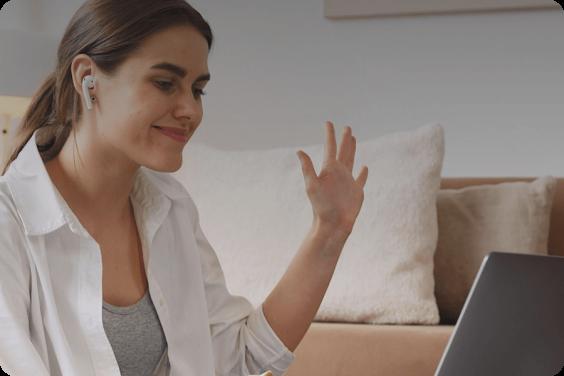Woman waving at a screen