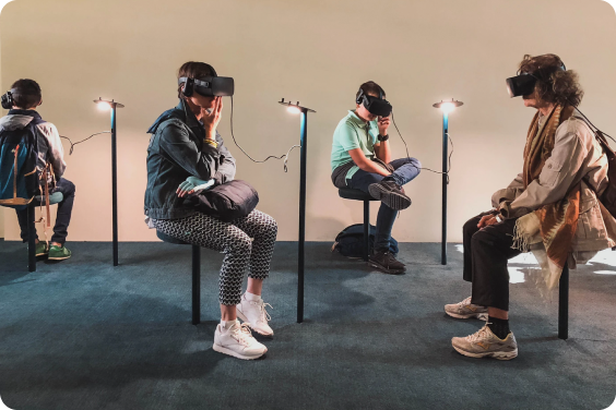 People using VR headsets in a room
