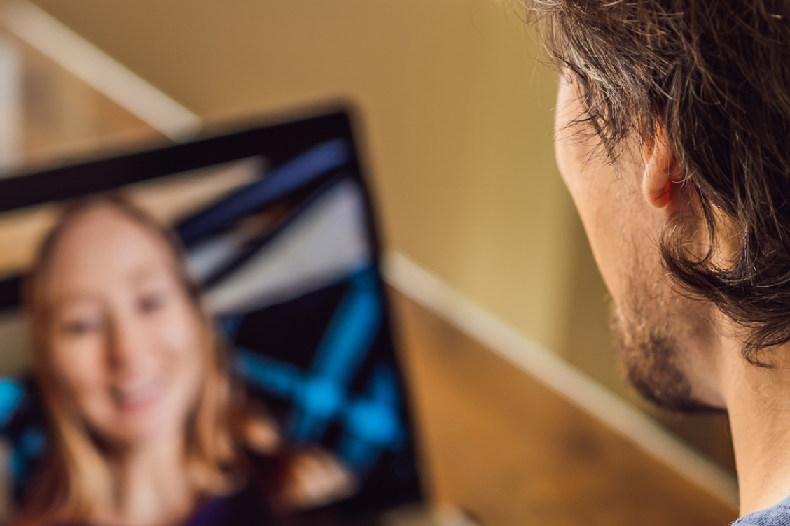 Man on a video call with a woman