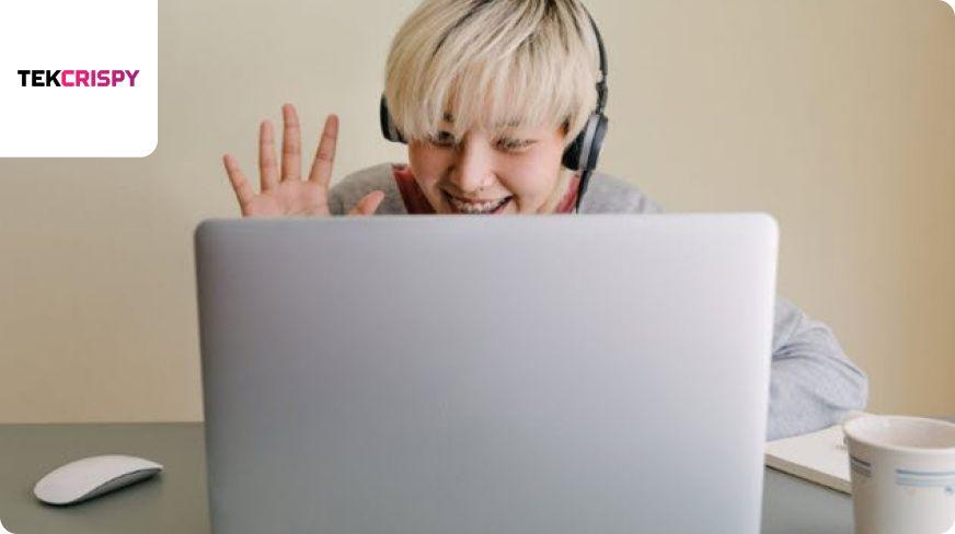 Man waving at laptop