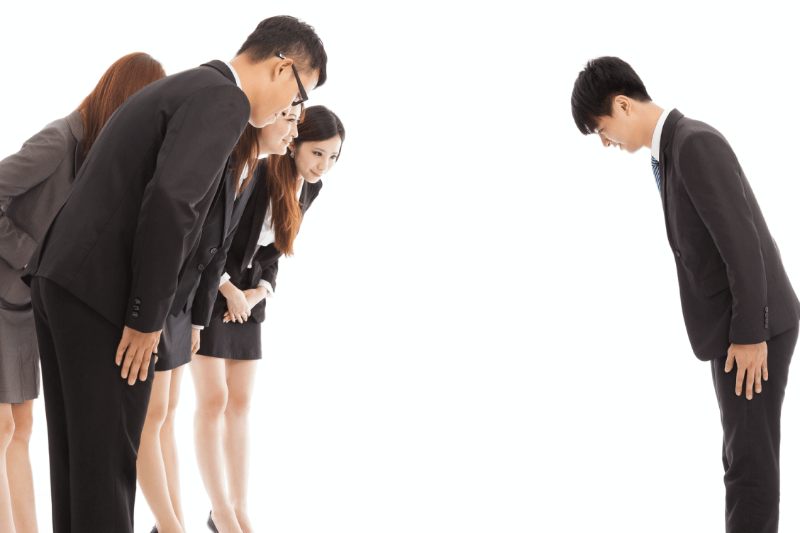 Group of people bowing to greet each other