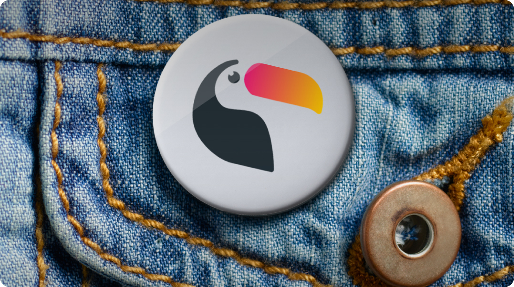 Badge with Toucan Events logo on it