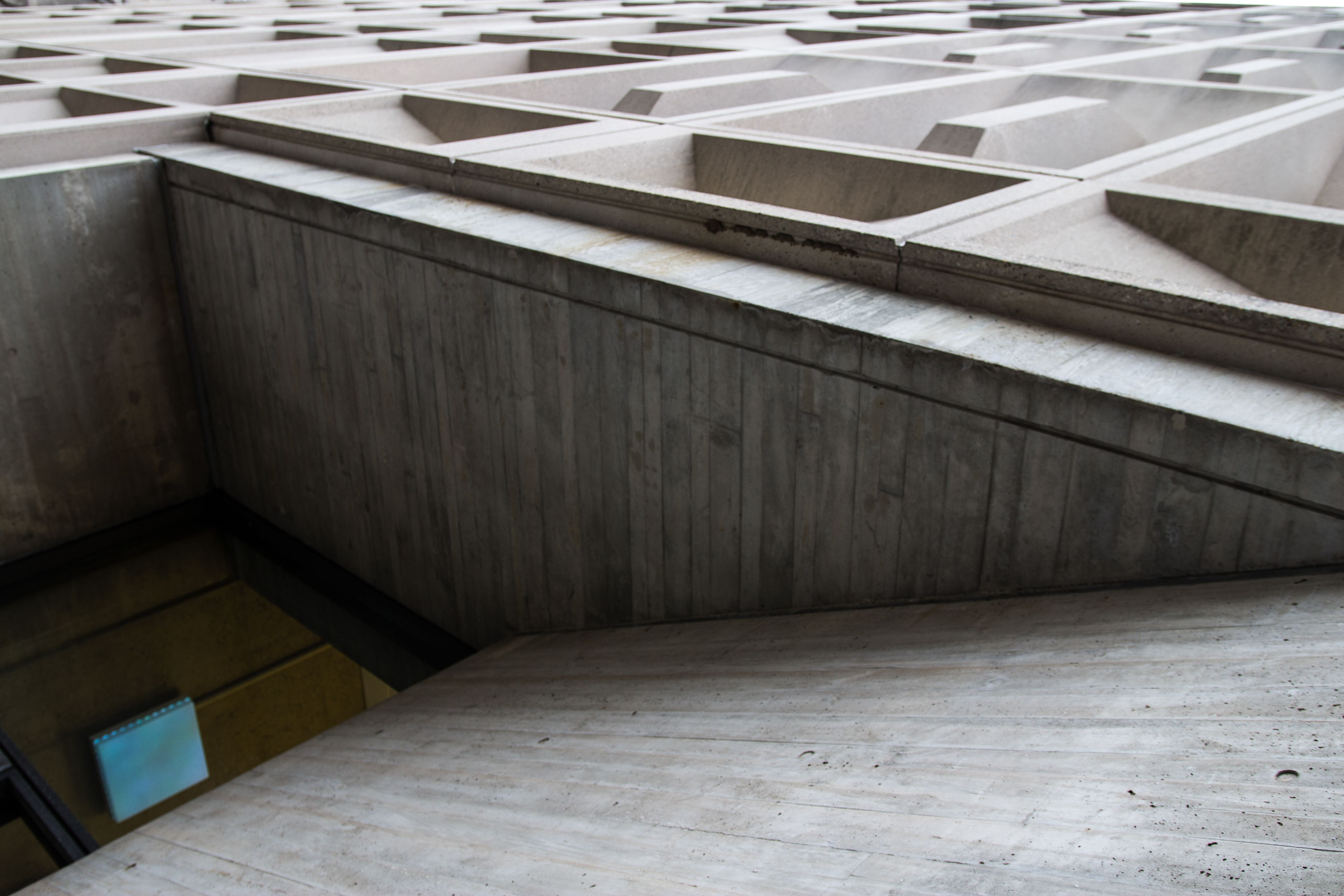 A modern concrete building, photographed at an angle that makes it unclear which way is up.