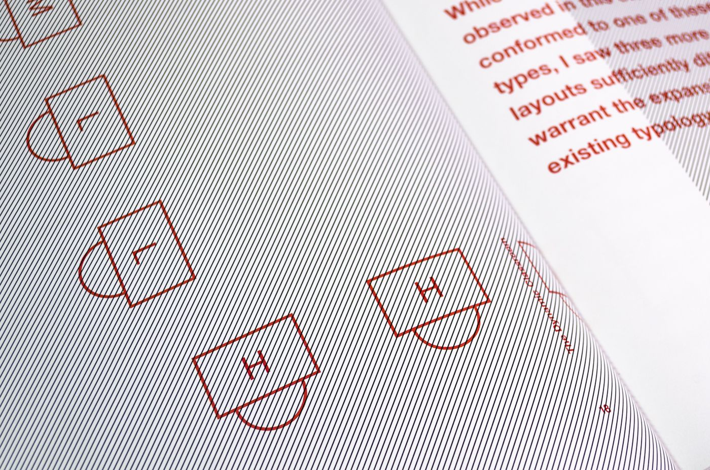 Detail of spread from The Dynamic Classroom. Thin black diagonal lines cover the page on the left. A diagram of classroom chairs is overprinted in red ink. The page on the right, which is out of focus, has text printed in red.