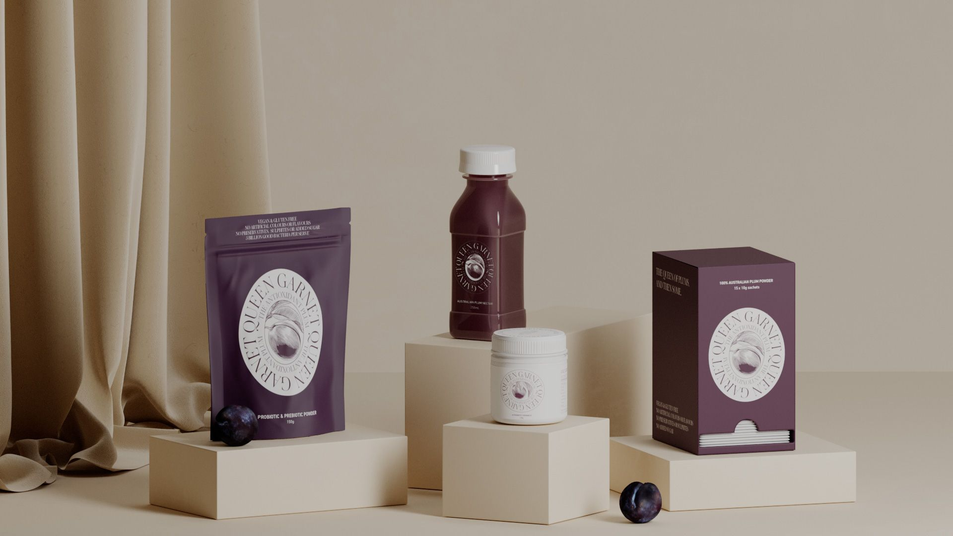 The range of Queen Garnet products sitting on a cream coloured background