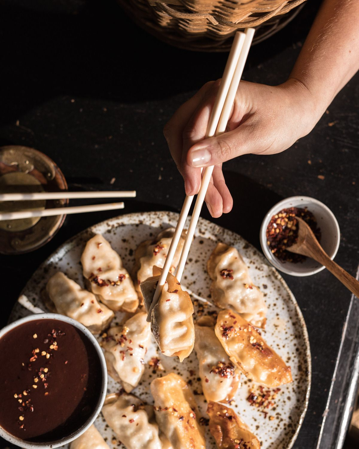 Chopsticks picking up dumplings, about to dip into Chinese Plum Sauce