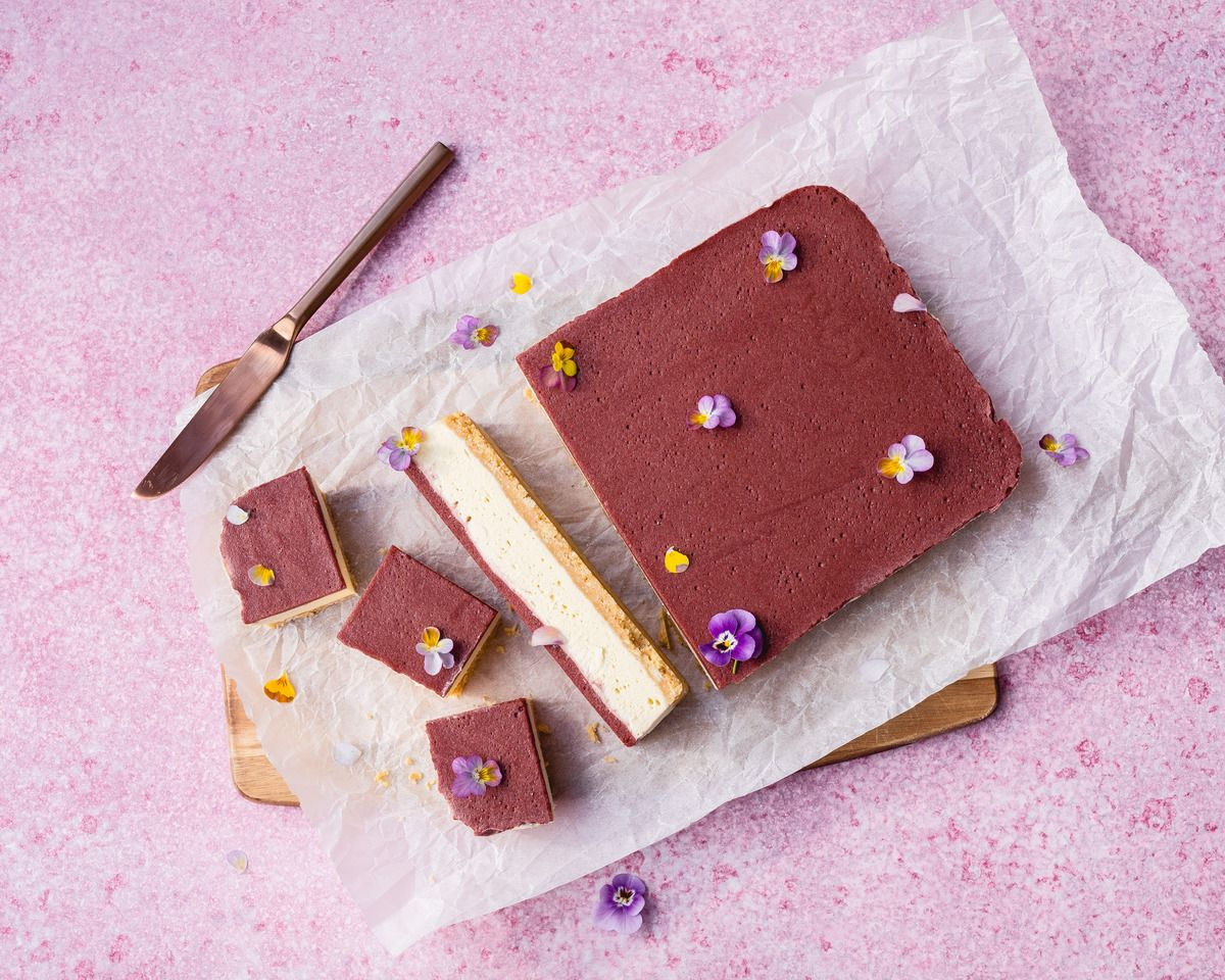 Plum + White Chocolate Cheesecake cut into small servings