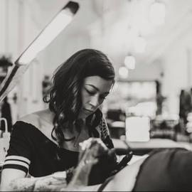Picture of Lucy doing a tattoo