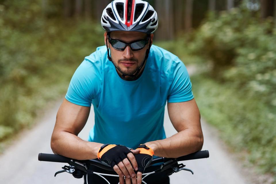 Man wearing the top sunglasses on his mountain bike