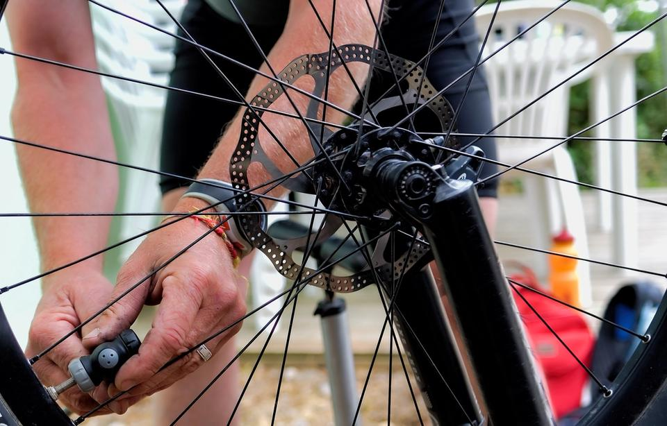 Man inflating bike tire with CO2
