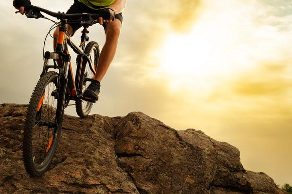 Man riding one of the best hardtail mountain bikes for less than $2000