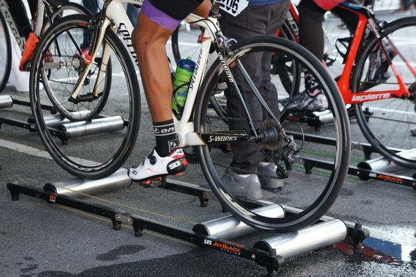Cyclists riding on bike rollers