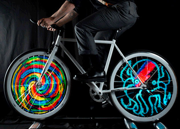 Bike on rollers with lights in wheels