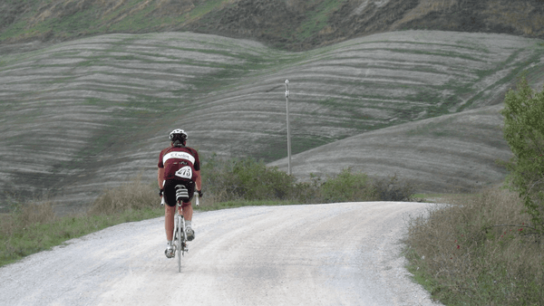 Man riding gravel bike on dirt road