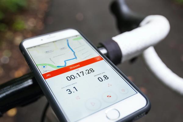 Phone mounted on road bike running Strava
