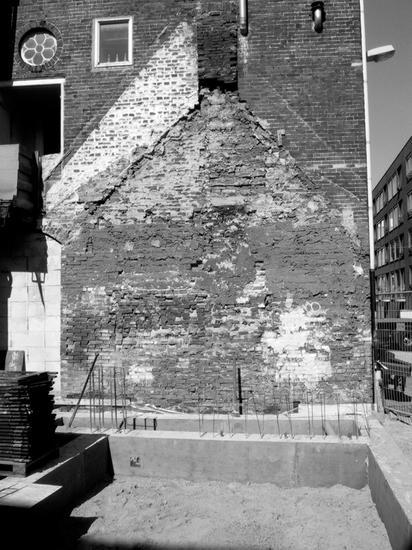 Black and white shot of worn brick wall