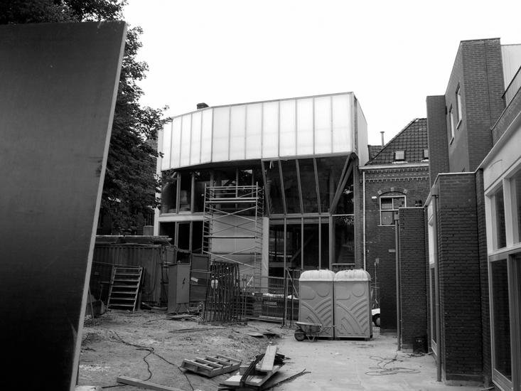 Black and white photo of front facade without much of the fabric