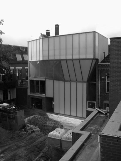 Photo of the entire front facade of the near finished house
