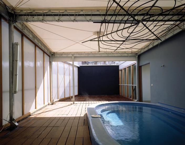 Color photo of third floor with the pool